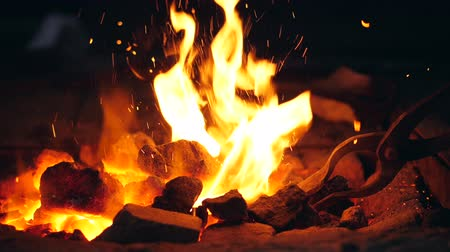fireplace : Slow motion mingling process of coals in the fire
