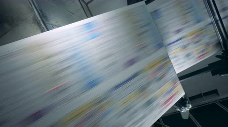 sahte : Fake news concept. Uncut printed paper rolling through the factory machine