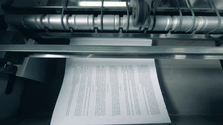 книжный магазин : Typographic machine is issuing and relocating printed paper