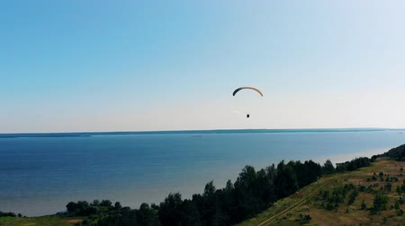 equipped : Blue river with a couple paragliding above it Stock Footage