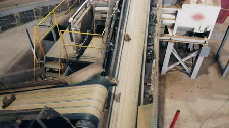 complex system : Pieces of ceramics are moving along the conveyor at the factory Stock Footage