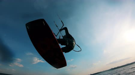 kitesurfer : Sportsman jumps while training with kiteboard.