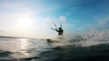 kiting : One man rides a kiteboard while training on water. Stock Footage