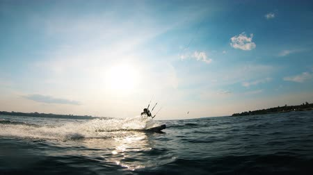 uçurtma : One sportsman training on surfing board with kite. Stok Video