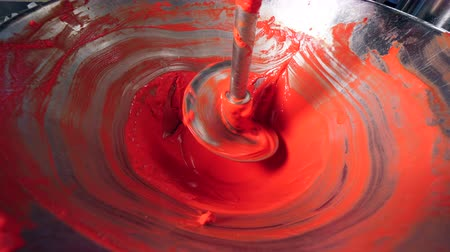 tayın : Spiral machine is mingling red-coloured paste
