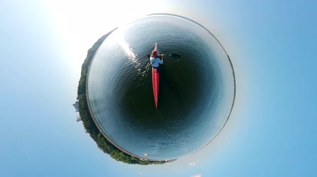 kürek çekme : 360-degree reverse panorama of a person sailing on a canoe Stok Video