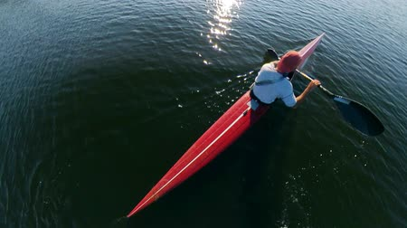 evezős : Top view of a kayak getting navigated by a person