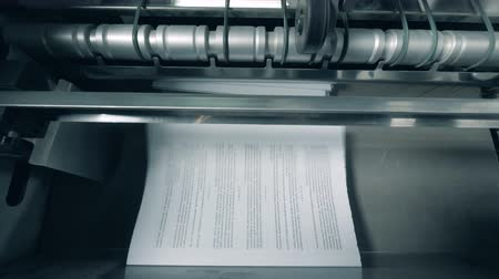 ofset : Printed pages with text stacked on a typographic line.