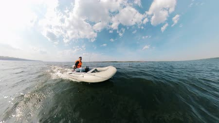 waters : Lake waters with a man sailing on an inflatable boat