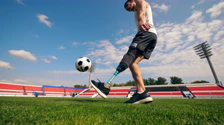 paralympics : Practice session of a handicapped footballer, soccer player