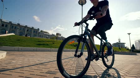 paralympics : Disabled man is managing a bicycle in motion Stock Footage