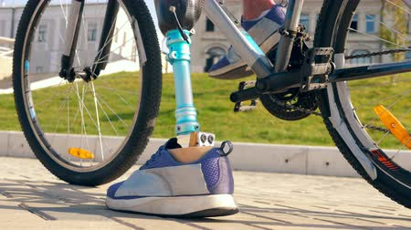 paralympics : Close up of a male bionic leg while riding a bike