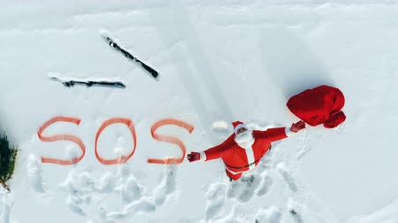 belongings : Screaming Santa Claus, skis and a SOS sign