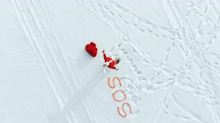 sós : SOS signal and Santa Claus shouting near it