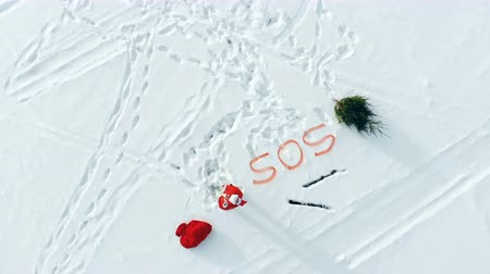klauzule : SOS sign in the snows and Santa Claus screaming