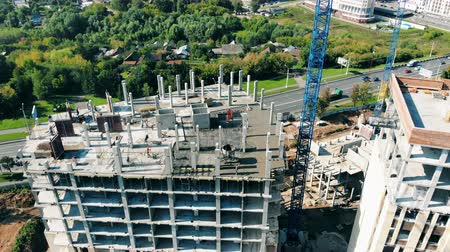 mechanizm : High-rise buildings under construction and tower cranes