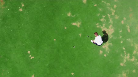 unlucky : A man is striking the golf ball past the hole. Fail, failure, bad day concept.