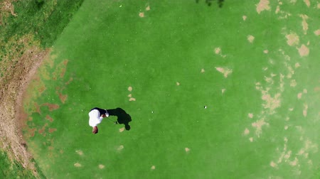 unlucky : The golf ball is rolling past the hole after the strike. Fail, failure, bad day concept.