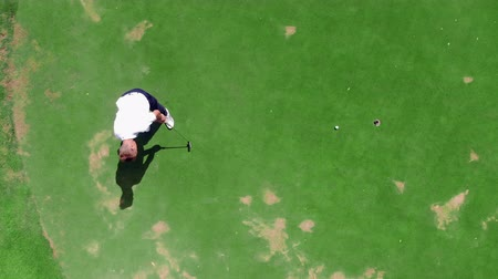 unlucky : Unsuccessful hit of the golf ball held by a man