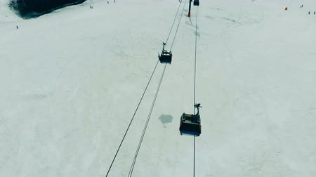 chair lift : Ropeway with moving funiculars in a top view. Ski elevator cable way in the mountains. Stock Footage