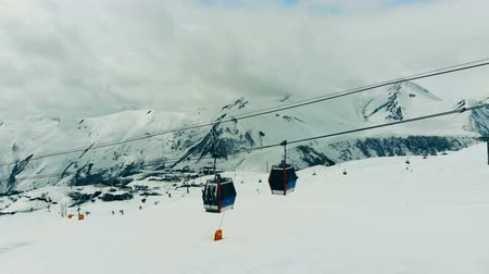 chairlift : Cable cars are moving in the mountain landscape. Ski lift in the mountains.