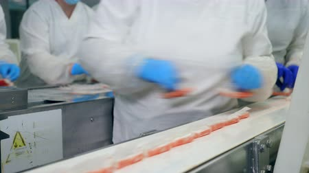 tayın : Factory technicians are removing crab sticks from the belt Stok Video