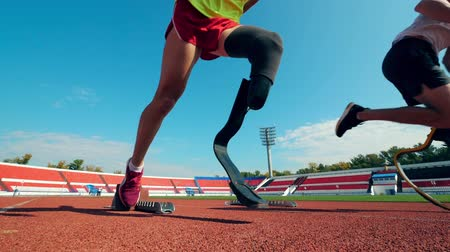 paralympics : Stadium with disabled athletes jogging Stock Footage