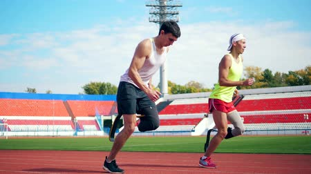 paralympics : Jogging practice of male handicapped athletes Stock Footage