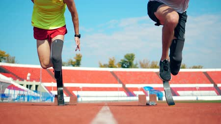 paralympics : Running start held by two male paralympians