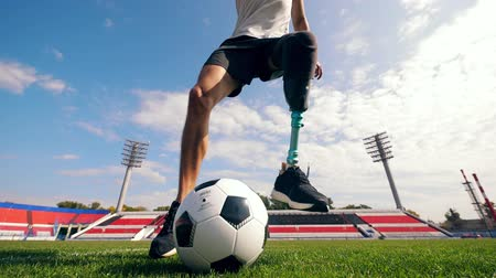 paralympic : Paralympic football player is dribbling the ball Stock Footage