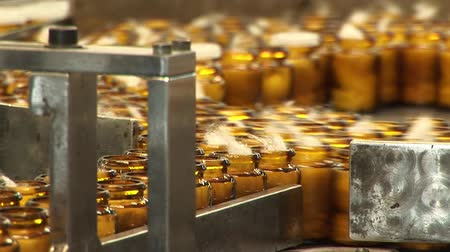 pharmaceuticals : Automated production of medicines. Packaging of tablets in a glass container