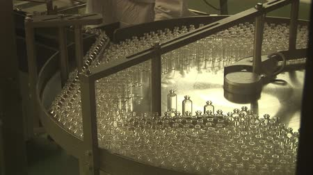 pharmaceuticals : Automated production of medicines. Filling drug vials Stock Footage