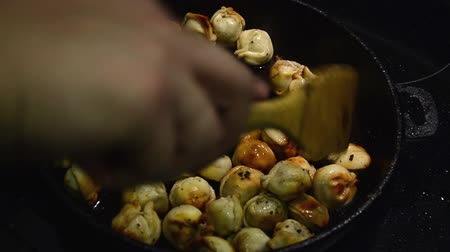 vareniki : Homemade dumplings fried with onion on a pan Stock Footage