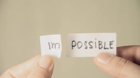 feasible : impossible turns to possible. Changing the word impossible to possible. Man makes the impossible possible Stock Footage