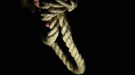 capital punishment : Man tying a noose. suicide, depressed man, gallows noose around his neck Stock Footage