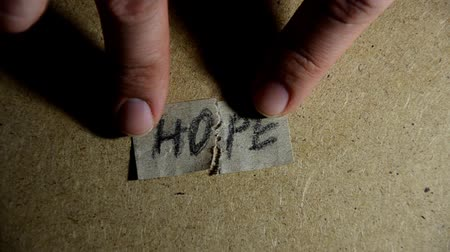 wielkanoc tło : Hope word concept. Pieces of Hope Wideo
