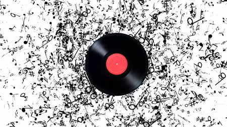 gravar : Vinyl record with a lot of notes. Vinyl record playing music Stock Footage