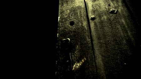 abandoned old : Gloomy Old wooden door opens Stock Footage