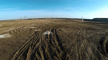 powerline : Dirty field. Power lines. Electricity. 22. Stock Footage