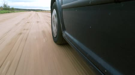 şartlar : The car moves on a gravel road. Stok Video