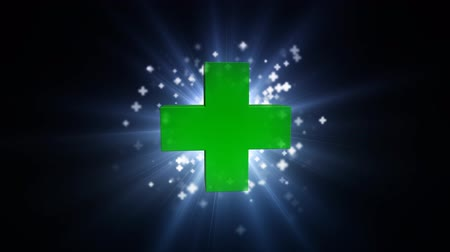 gyógyszertár : Big green cross with bright light. Bright beam of light with crosses Stock mozgókép