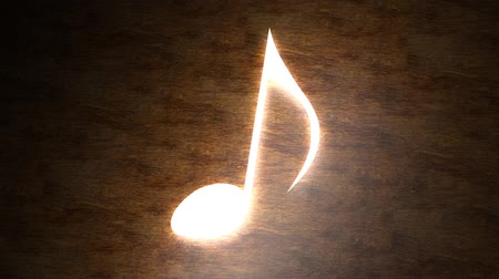 hangjegykulcs : Glowing musical note on the table. The magic of music. Note with rays of light.