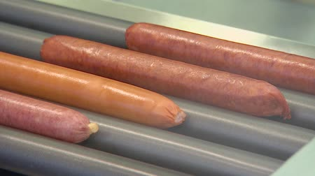 mustard : Cook beautiful hot dogs. Juicy Sausages rotate on the grill.