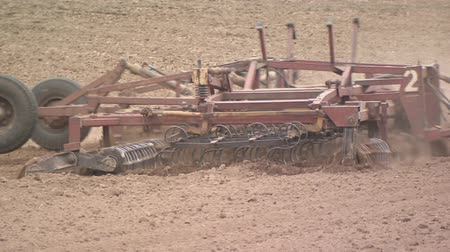 tillage : Plow the field. Agriculture. Agricultural machinery is preparing for planting a crop.