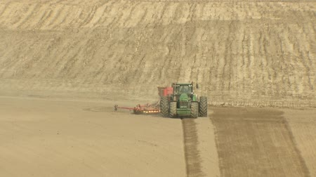 Preparing the land for planting the crop. Agricultural machinery plows the land