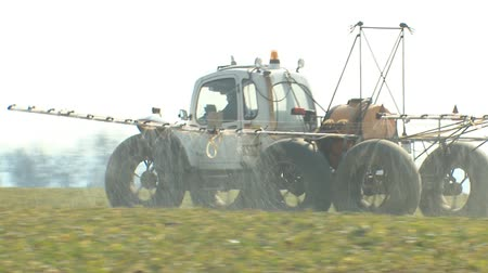 soya : Field oressing. Irrigation machine fertilizes the earth. Good harvest. Fertilizer of agricultural crops.