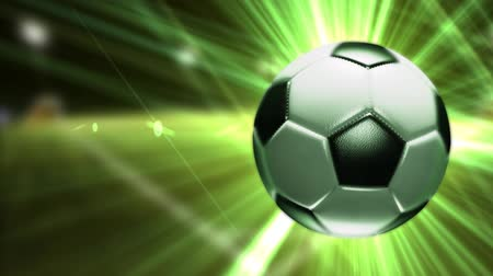 Background with a soccer ball. Soccer ball with bright green rays. Stok Video