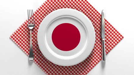 National dishes of Japan. Delicious recipes from Europe. Flag on a plate with food from Japan.