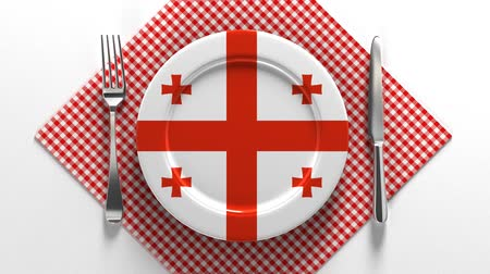 National dishes of Georgia. Delicious recipes from Europe. Flag on a plate with food from Georgia. Stok Video