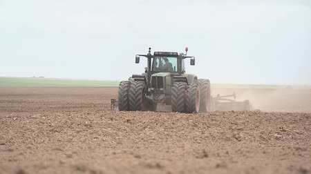 The technique plows fields, preparing land for planting agricultural crops.